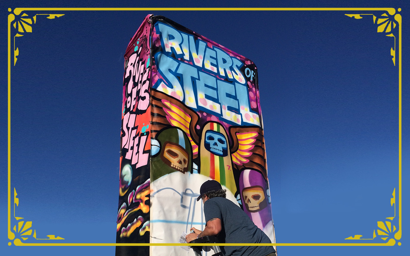 artist Matt sphar paints a mural tower
