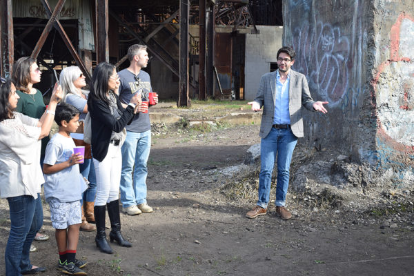 artist nick liadis speaks to a crowd about his 2015 installation