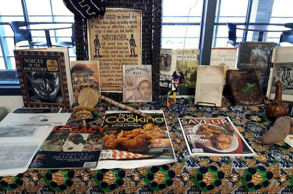 Books, Magazines & Photos displayed on kente cloth