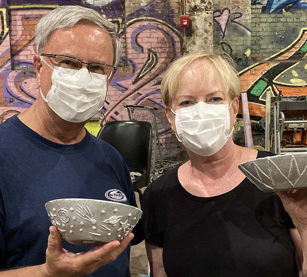 A couple display the doodle bowls.
